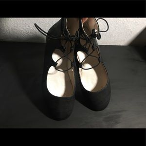 Cute and comfy barely worn black lace up flats.